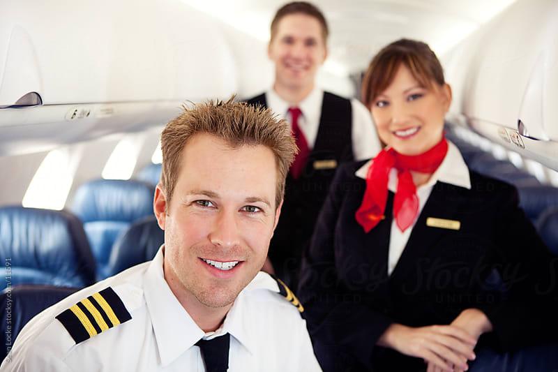 Airplane: Cheerful Flight Crew Ready to Go by Sean Locke for Stocksy United