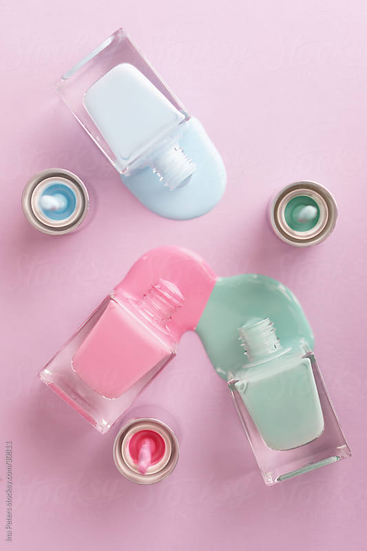 Objects: Pastel coloured nail polish leaking by Ina Peters for Stocksy United