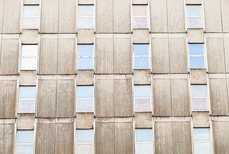 Windows and concrete. by Audrey Shtecinjo for Stocksy United