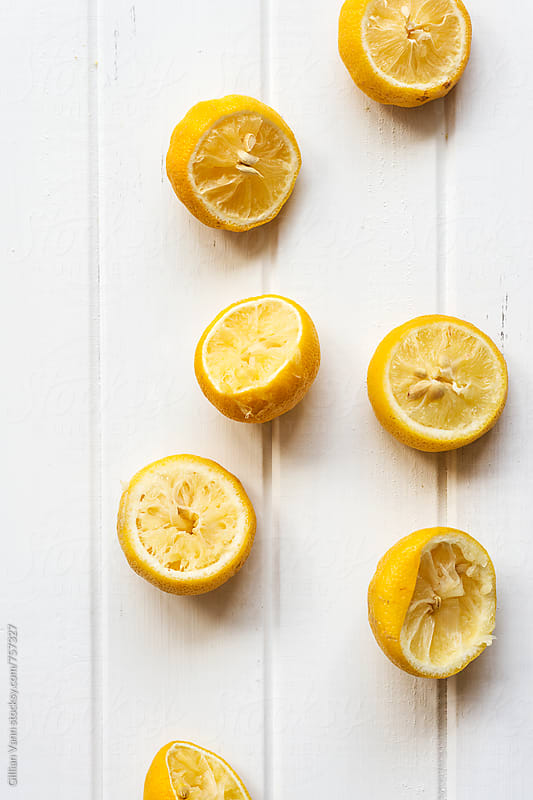 squeezed lemons by Gillian Vann for Stocksy United