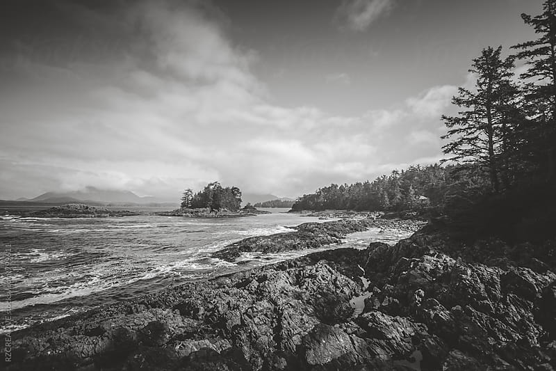 Black and white image of a remote and rocky beach along the west coast of Vancouver Island. by Robert Zaleski for Stocksy United