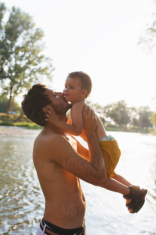 Father and son refreshing. by Dejan Ristovski for Stocksy United
