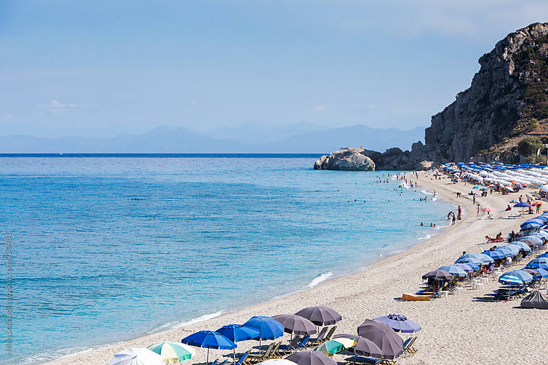 Beach with Umbrellas and Lounge Chairs on a Greek Island by Helen Sotiriadis for Stocksy United