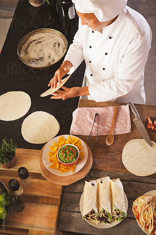 Mexican Chef Baking Tortillas by Lumina for Stocksy United
