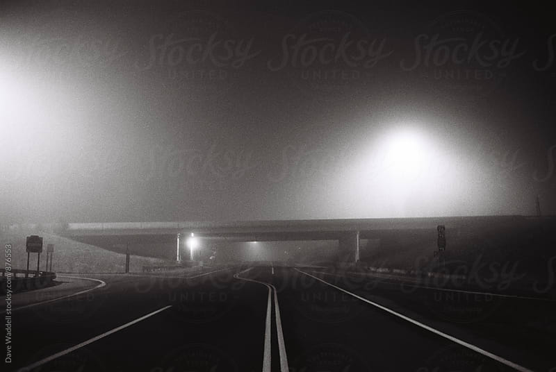 Empty Road at Night by Dave Waddell for Stocksy United