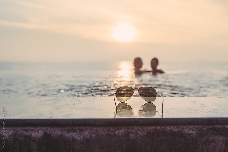 Couple in the Infinity Pool by Mosuno for Stocksy United