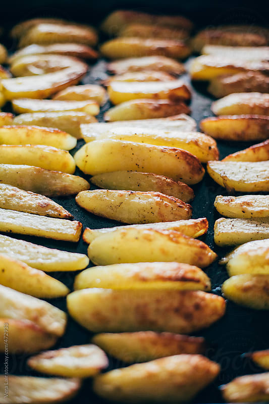 Roasted potatoes by Vera Lair for Stocksy United