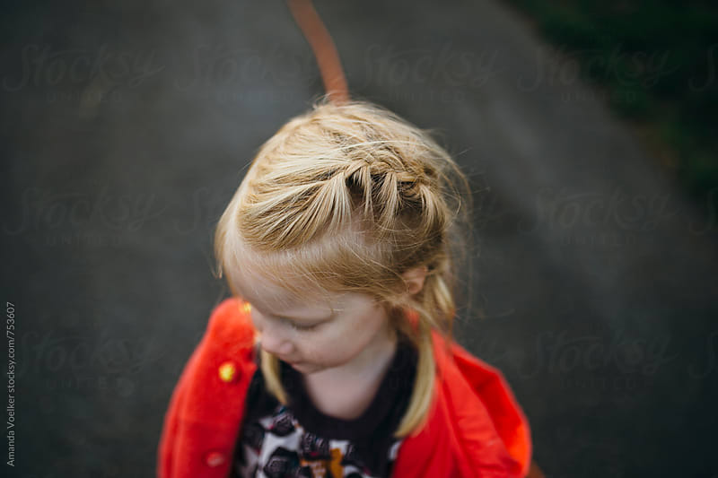 Birds Eye View of a Young Girl with Blonde Hair in french braid pigtails by Amanda Voelker for Stocksy United