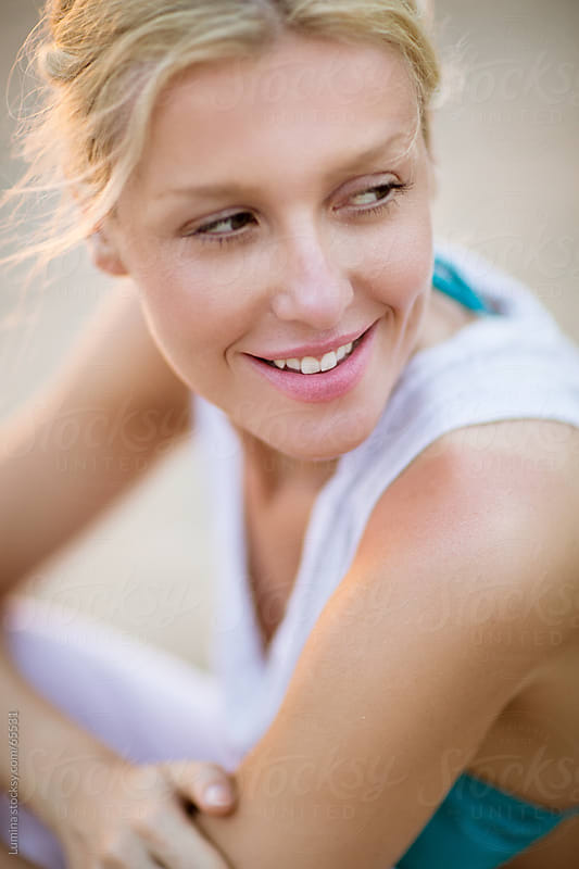 Smiling Blond Woman Outdoors by Lumina for Stocksy United