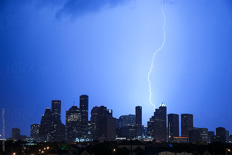 Lightning bolt hitting the Houston skyline by yuko hirao for Stocksy United