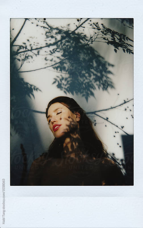 Beautiful young woman polaroid portrait photo by Nabi Tang for Stocksy United