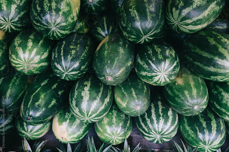 Watermelons stacked by Christian Gideon for Stocksy United