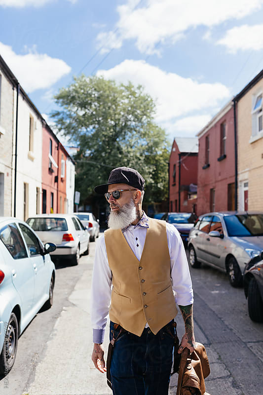 Eccentric Stylish Senior Man Portrait Walking on the Streets by HEX . for Stocksy United