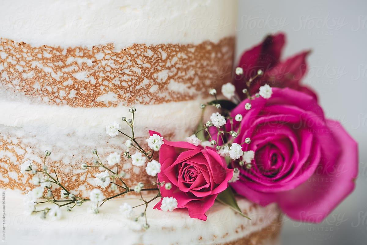 Wedding Cake Decorated With Fresh Flowers Stocksy United