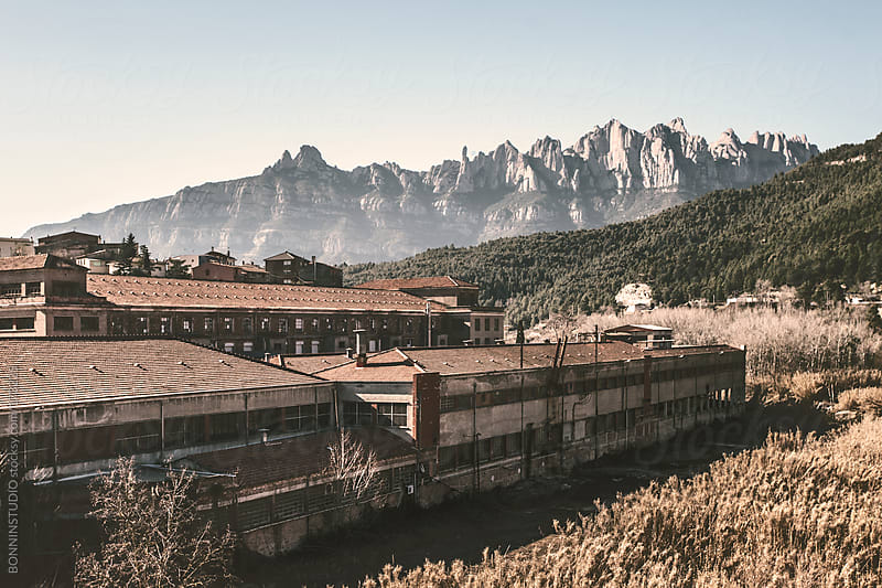 Old textile manufactures with Montserrat mountains on background. by BONNINSTUDIO for Stocksy United