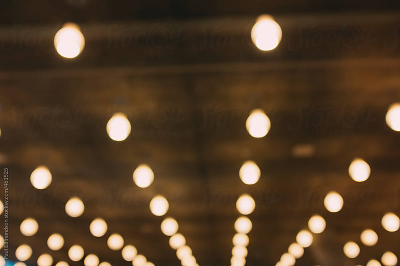 Rows of lights in modern building, blurred focus by Paul Edmondson for Stocksy United