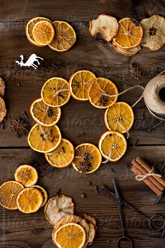 Fragrant homemade orange Christmas wreath by Pixel Stories for Stocksy United