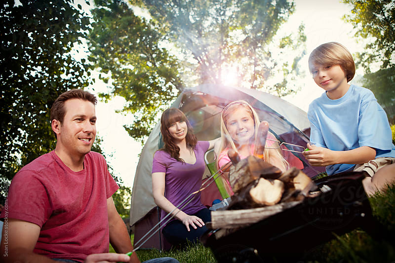 Camping: Getting Ready to Have Hot Dogs for Dinner by Sean Locke for Stocksy United