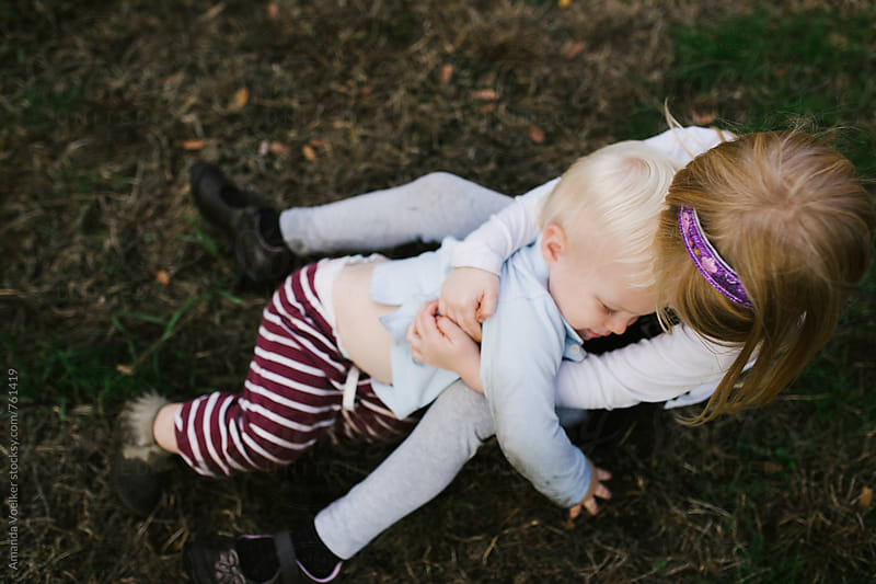 Birds eye View of Young Siblings Embracing by Amanda Voelker for Stocksy United