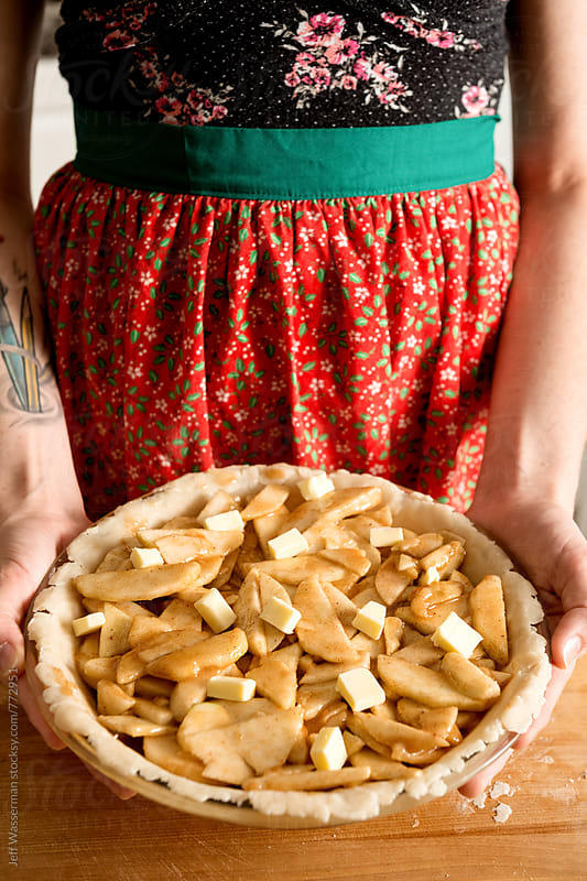 Making Apple Pie: Filled Up  by Jeff Wasserman for Stocksy United