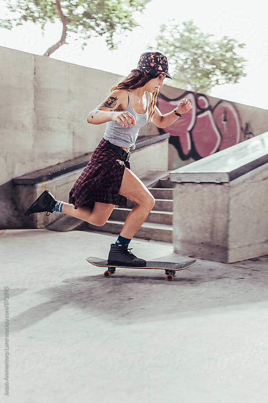 Young girl skateboarding at skate park by Jacob Lund for Stocksy United