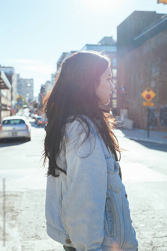 Young asian woman walking outdoors by Good Vibrations Images for Stocksy United