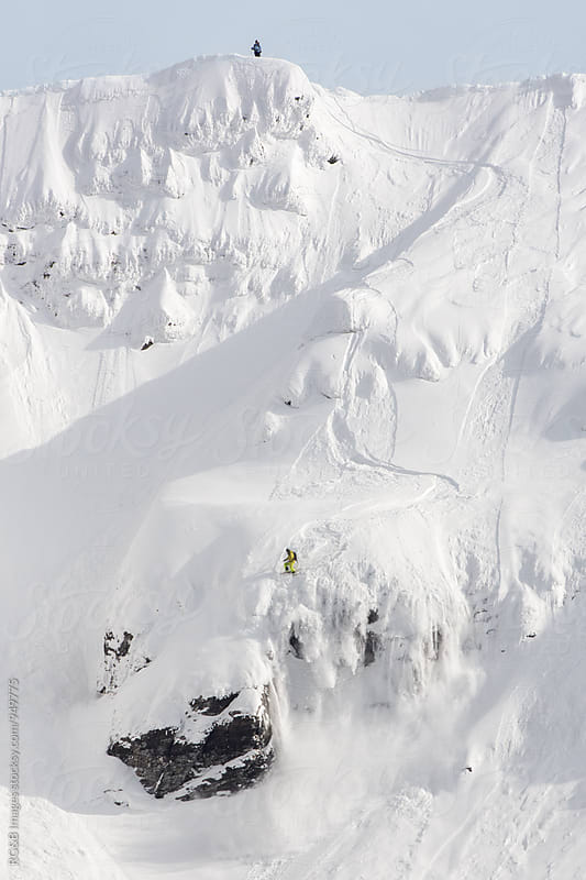 Skier on the edge of the cliff by RG&B Images for Stocksy United