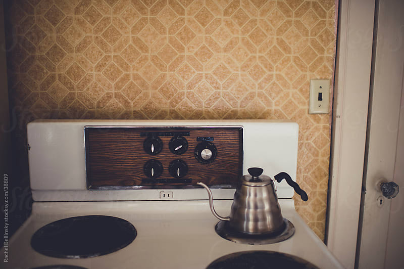 Vintage stove and kettle in old apartment by Rachel Bellinsky for Stocksy United