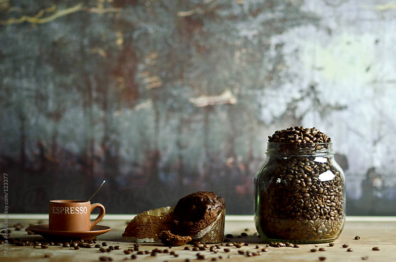 Coffee beans in jar,chocolate muffin and cup of coffee on wooden table by Marija Anicic for Stocksy United