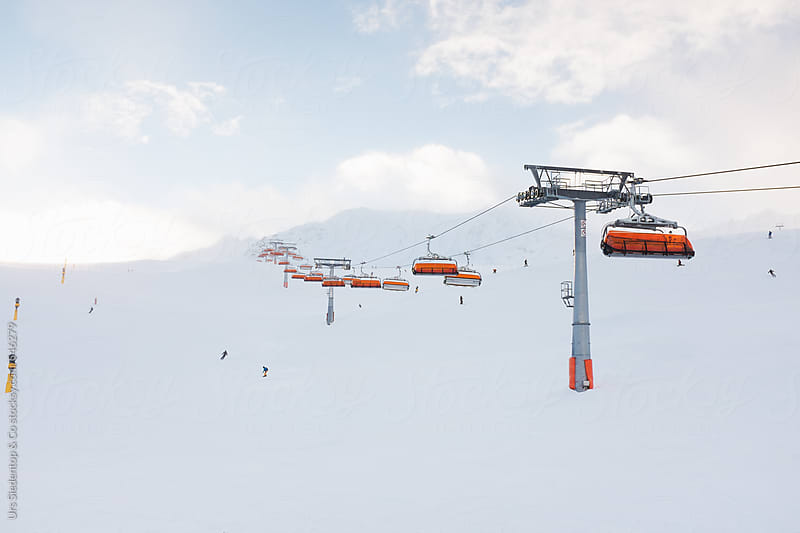 Skiing slope and chairlift by Urs Siedentop & Co for Stocksy United