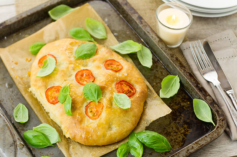 Tomato and basil focaccia horizontal by Kirsty Begg for Stocksy United