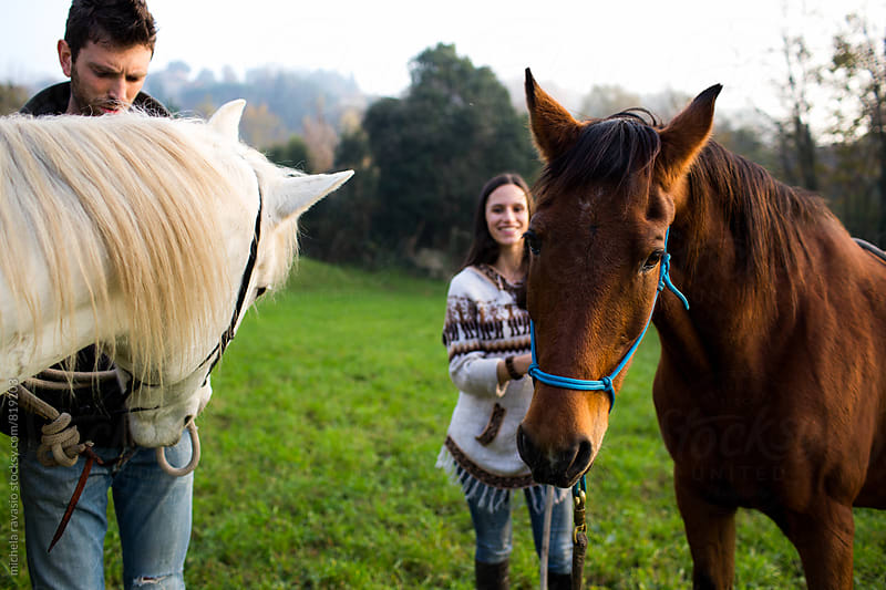 Friends enjoying a day in nature with their horses by michela ravasio for Stocksy United