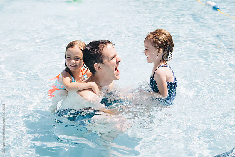Family Splash by Ali Lanenga for Stocksy United