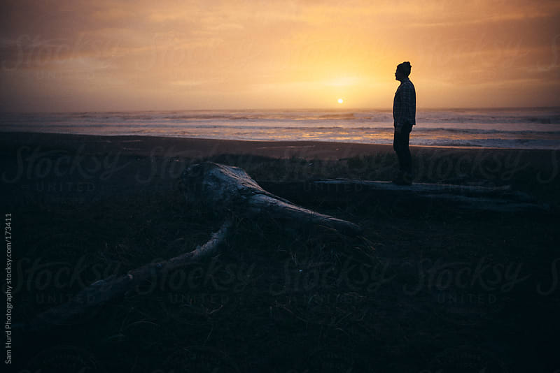 man at sunset by Sam Hurd Photography for Stocksy United