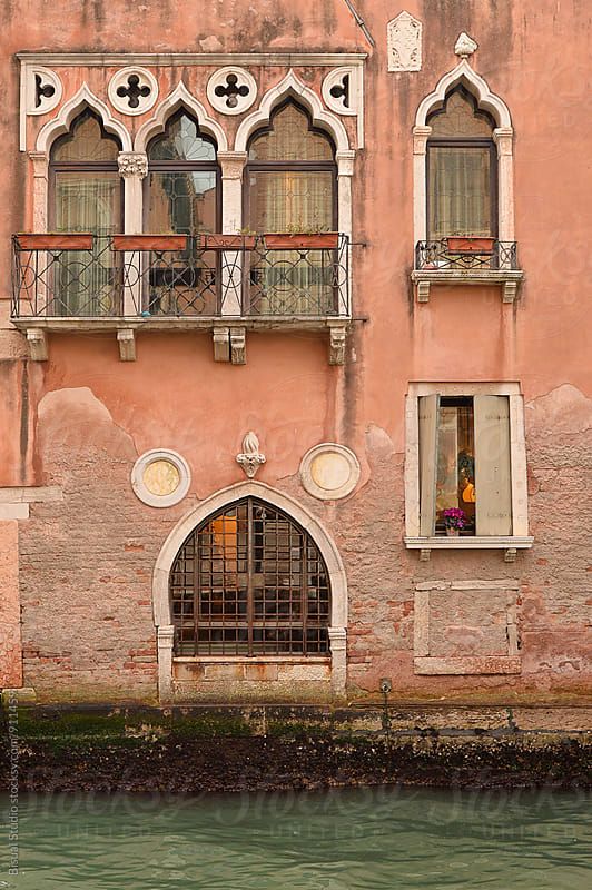 Venetian house in front of a canal by Bisual Studio for Stocksy United