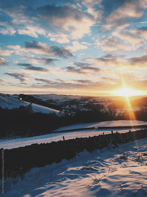 Beautiful winter sunset by Neil Warburton for Stocksy United