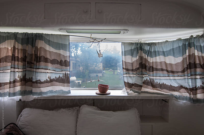 looking through a vintage trailer window  by Margaret Vincent for Stocksy United