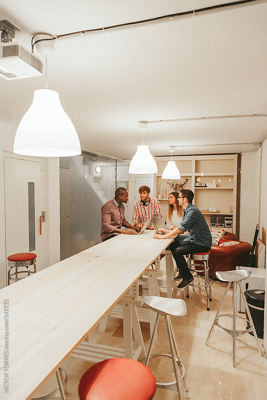 Young Entrepreneurs Working at the Office by VICTOR TORRES for Stocksy United