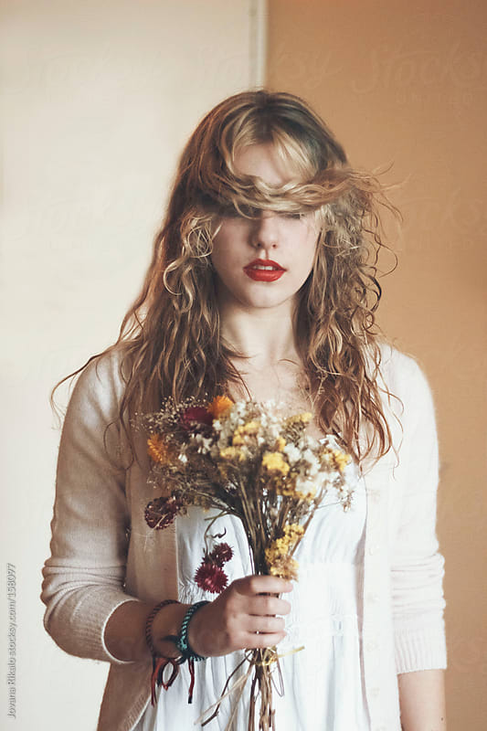 Giril holding flower bouquet by Jovana Rikalo for Stocksy United