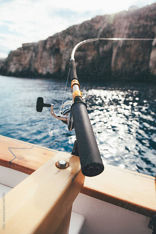Flexible Fishing Pole on the Boat by HEX. for Stocksy United
