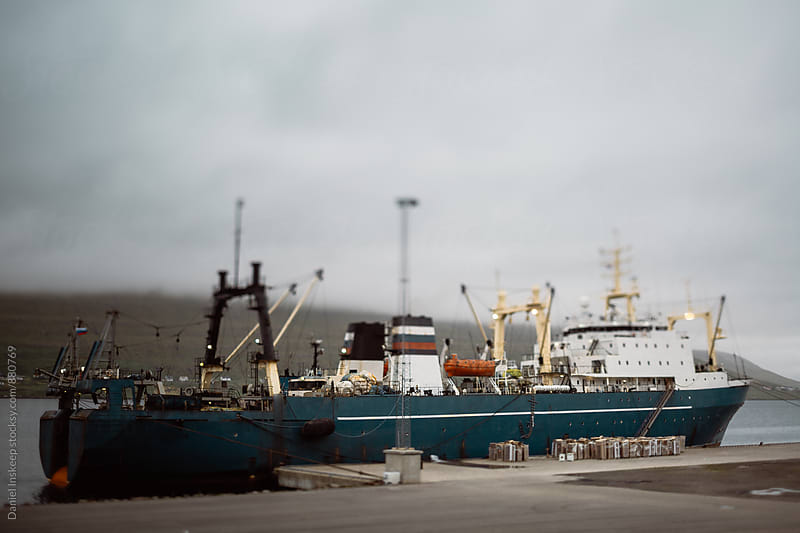 A Ship Docked in the Faroe Islands by Daniel Inskeep for Stocksy United