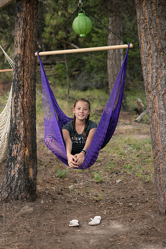 Preteen Girl Hanging In Hammock by Ronnie Comeau for Stocksy United