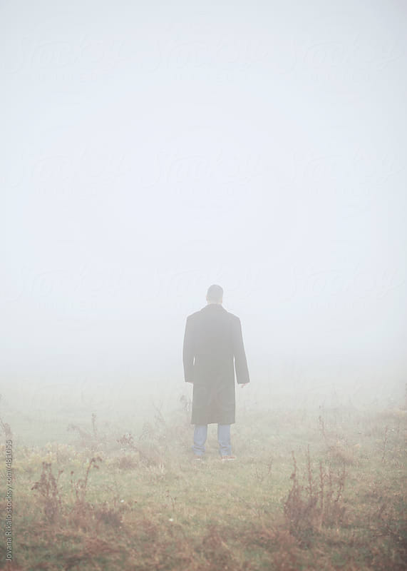 Man in fog by Jovana Rikalo for Stocksy United
