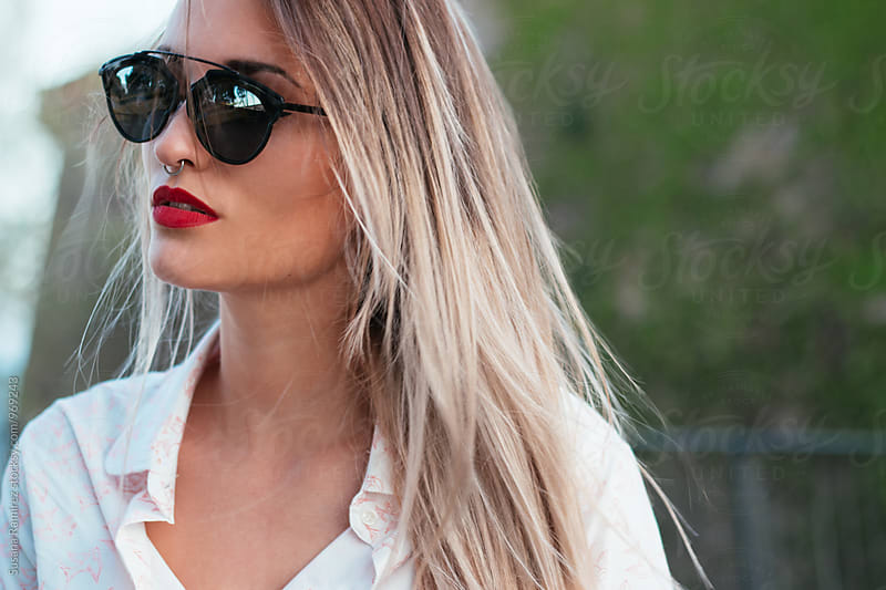 Portrait of beautiful woman with sunglasses by Susana Ramírez for Stocksy United