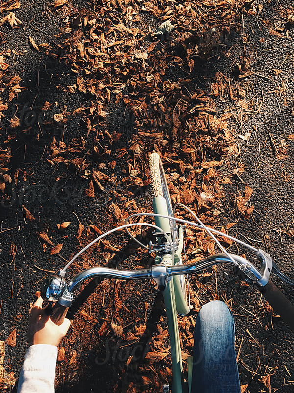 Cycling in Fall by Kirstin Mckee for Stocksy United