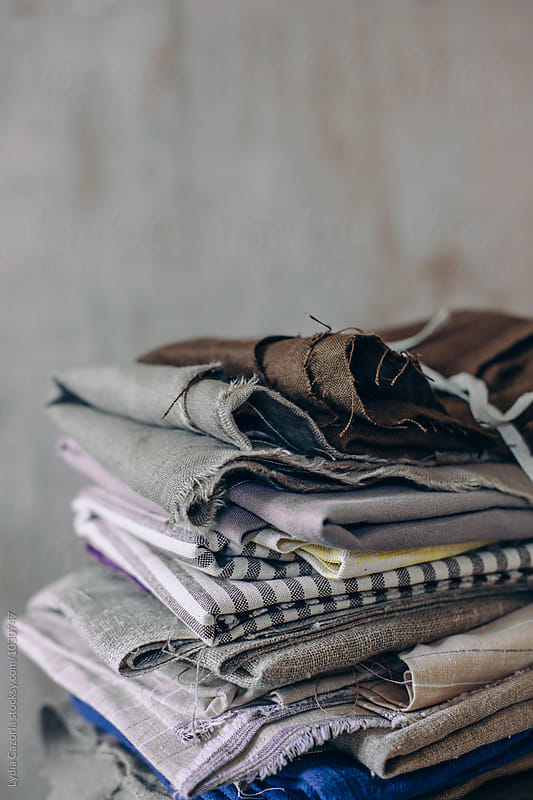 Stack of tied fabrics by Lydia Cazorla for Stocksy United