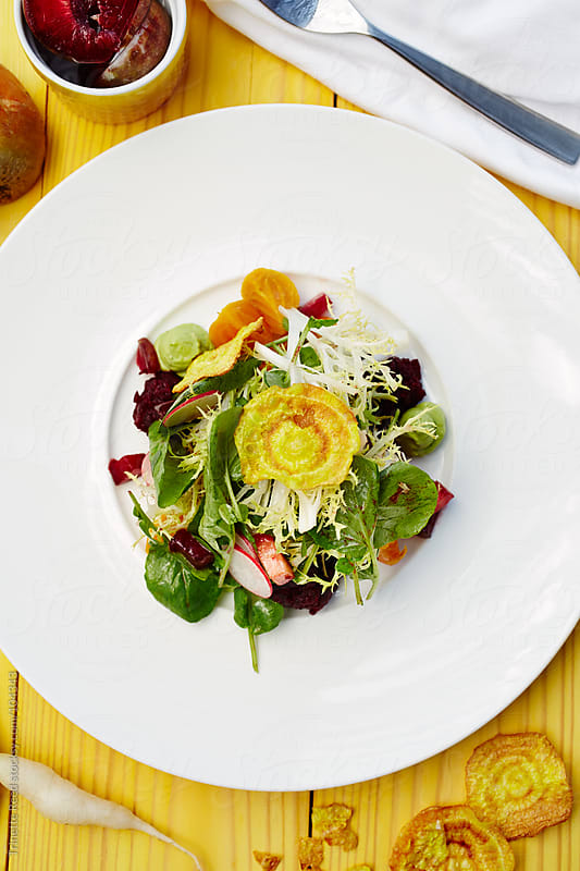 Salad with fresh and dehydrated beets and plums by Trinette Reed for Stocksy United