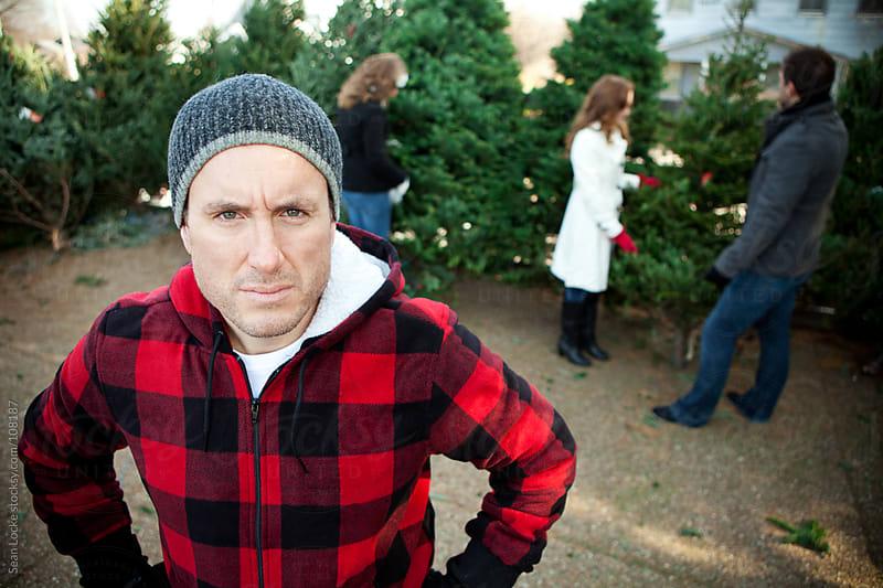 Tree Lot: Disgruntled Tree Lot Worker by Sean Locke for Stocksy United