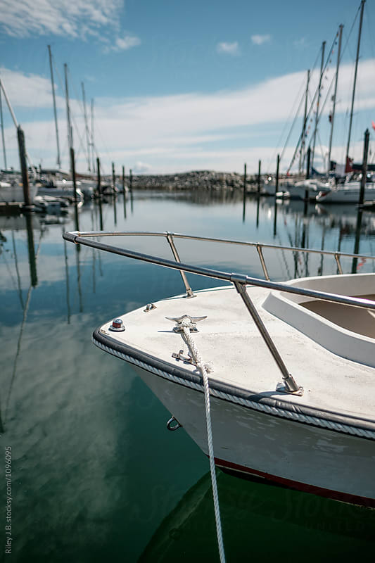 Bow of  a small boat in a harbour by Riley J.B. for Stocksy United