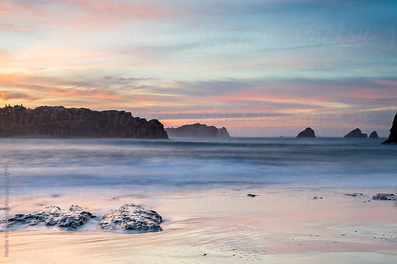 Dramatic sunset over a rocky coastline by Marilar Irastorza for Stocksy United